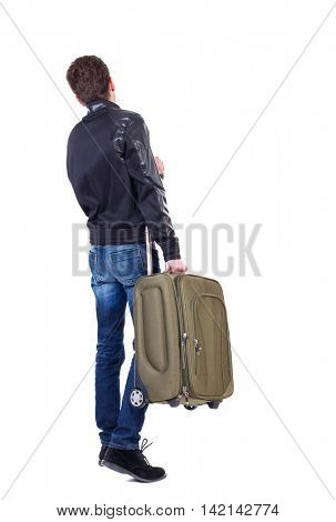 Back view of man with  green suitcase looking up. Rear view people collection.  backside view of person.  Isolated over white background. The traveler carries a suitcase.