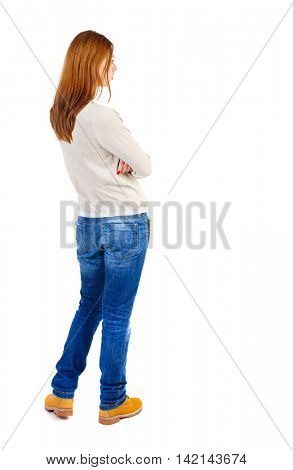 back view of standing young beautiful  woman.  girl  watching. Rear view people collection.  backside view of person. Girl in a white jacket standing with arms folded and looking to the right.