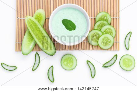 Natural ingredient for skincare and scrub with cucumber, avocado and mint isolated on white background