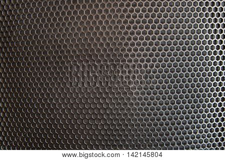 Close-up of black metal reticulated cells industrial background