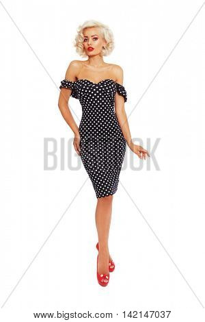 Young beautiful slim sexy platinum blonde woman in vintage polka dot dress over white background