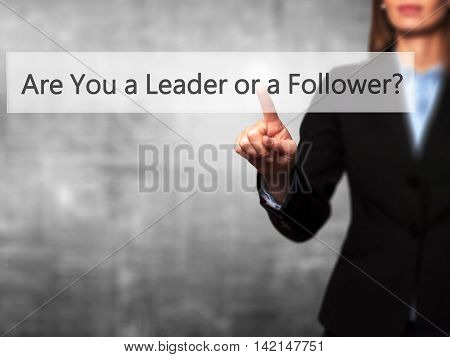 Are You A Leader Or A Follower ? - Isolated Female Hand Touching Or Pointing To Button