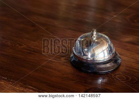 Vintage chrome service bell on wooder bar