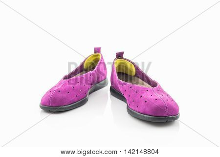 Purple sneakers on a white background. Canvas Shoe.
