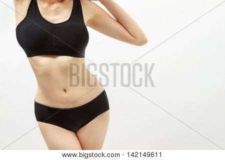 Beautiful Fitness Model Measures The Waist On White Background,healthcare Concept,healthy Content An