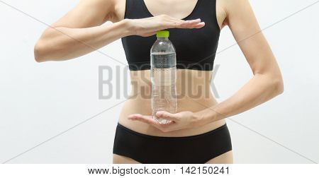 Beautiful Fitness Athlete Woman Drinking Water On White Background,healthy Concept,healthcare Conten