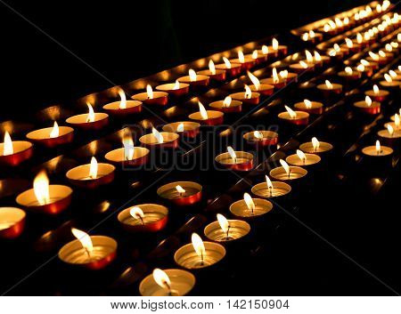Candles Lit Inside The Place Of Worship To Pray