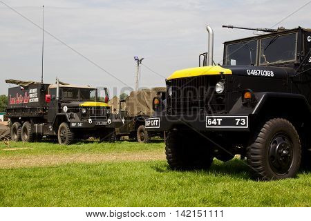 WESTERNHANGER, UK - JULY 20: Vintage ex US army gun trucks are parked in one of the many living history setups at the War & Peace Revival show on July 20, 2016 in Westernhanger