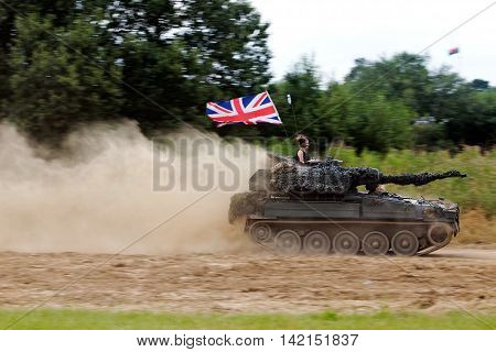WESTERNHANGER, UK - JULY 21: An ex British army vintage Alvis light tank races around the main arena for the public to view at the War & Peace Revival show on July 21, 2016 in Westernhanger