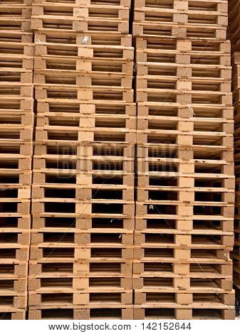 Stacked New Wooden Pallets In Logistic Stock