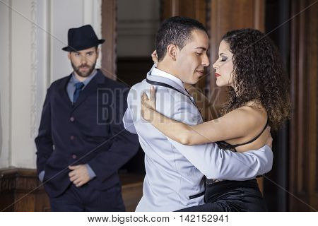 Tango Dancers Performing While Man Looking At Them