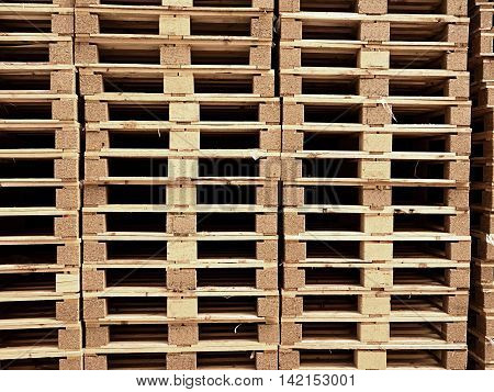stacked new wooden pallets in logistic warehouse