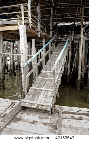 The wooden ramp climb up from ferry landing to the second floor of river side restaurant.