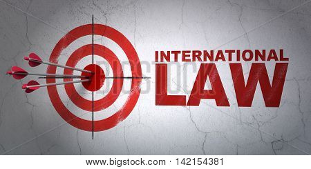 Success political concept: arrows hitting the center of target, Red International Law on wall background, 3D rendering
