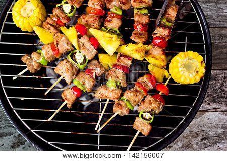 bbq and corncob on a grilling pan, View top . kebab bbq