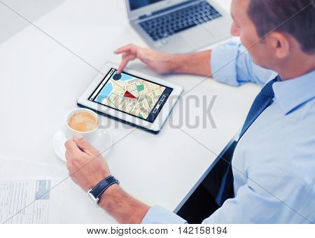 business, people, technology and navigation concept - businessman with gps navigator map on tablet pc screen drinking coffee in office