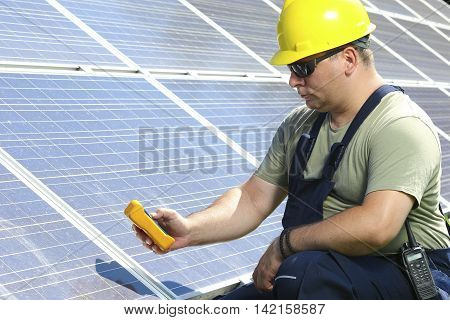 Worker is measuring solar insolation on the solar power plant