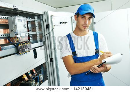 electrician engineer worker with blueprint project