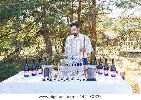 Bartender at work at the open air wedding banquet