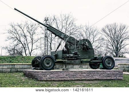 Anti-aircraft machine gun of the World war II. War industry. Cold photo filter. Biggest war campaign of 20th century. Weapons theme. Exposed artillery.