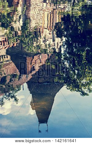 Beautiful Vajdahunyad castle is reflected in the water of the lake Budapest Hungary. Cultural heritage. Travel destination. Vertical composition. Famous place. Vintage photo filter. Architectural theme.