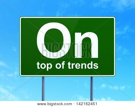 Finance concept: On Top of trends on green road highway sign, clear blue sky background, 3D rendering