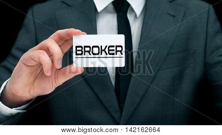 Young broker showing his business card. Concept of providing advice by financial advisor