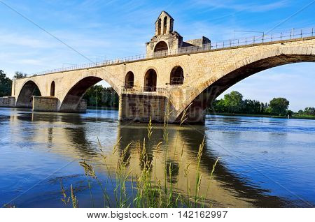 a view of the Pont Saint-Benezet or Pont d'Avignon bridge, in Avignon, France, over the  Rhone River