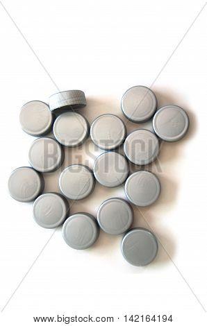group of bottle caps on white background