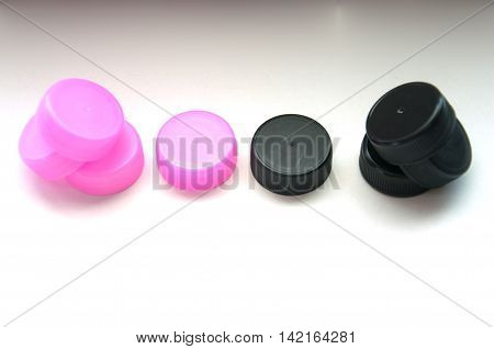 Black and pink recycled plastic bottle caps