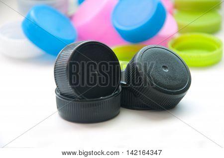 many plastic bottle caps on white background