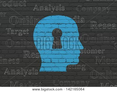 Marketing concept: Painted blue Head With Keyhole icon on Black Brick wall background with  Tag Cloud