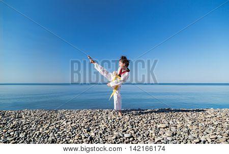 The girl training on the beach: Taekwondo, sports