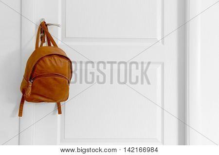 Schoolbag hanging on door