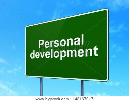 Learning concept: Personal Development on green road highway sign, clear blue sky background, 3D rendering