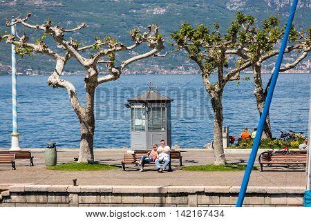 TORRI DEL BENACO - MAY 4, 2016: Garda lake with promenade in Torri del Benaco Italy