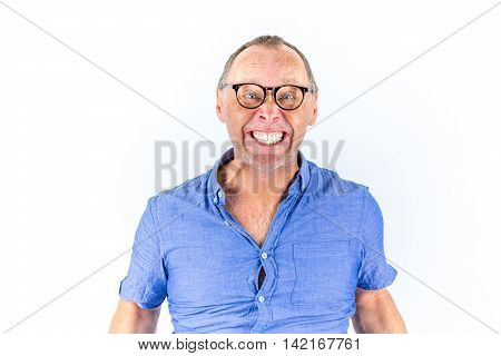 Angry and furious man with glasses, portrait.