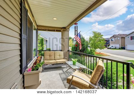 Cozy Porch With Sitting Area And Flower Bed