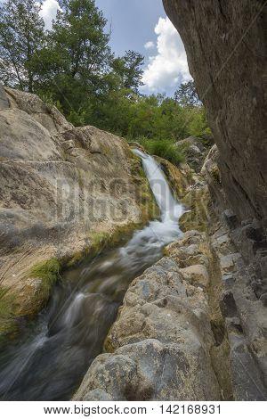 beautiful small waterfall between rocks. Long Exposure