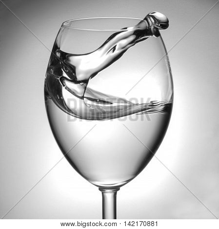 Water stroke/wave jumps out of a wine glass