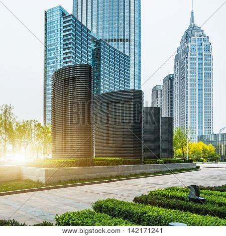financial district with green beside the pavement