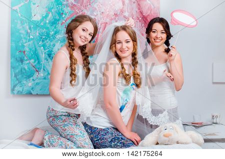 Cheerful Young Girls Celebrate A Bachelorette Party At Home