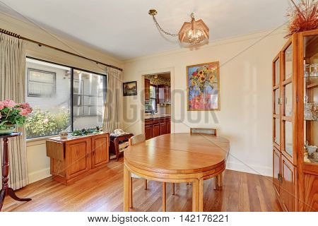 Cozy Dining Room Interior With Oval Wooden Table