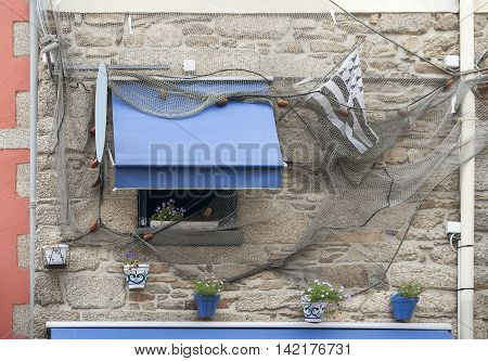 house facade in the old town of Concarneau in the Finistere department of Brittany in France
