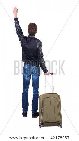 Back view of man with  green suitcase man greeting waving from his hands. Rear view people collection.  backside view of person.  Isolated over white background. Tourist holding the handle of a