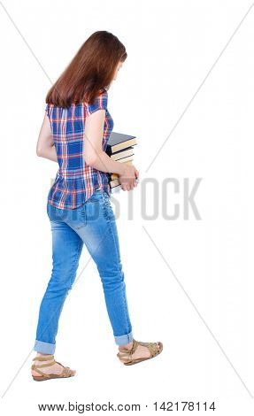 Girl comes with  stack of books. back side view. Rear view people collection.  backside view of person.  Isolated over white background. Girl in a plaid shirt goes with a pile of books in hands