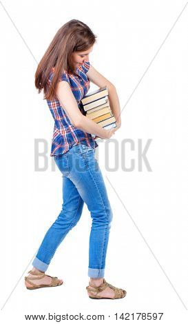Girl carries a heavy pile of books. back view.  Rear view people collection.  backside view of person.  Isolated over white background. Girl in plaid shirt trying more convenient to pick up a stack of