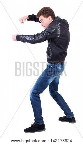 back view of guy funny fights waving his arms and legs. Isolated over white background. Rear view people collection.  backside view of person. Curly guy in a black leather jacket funny fights
