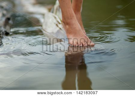 Girls Legs On The Water