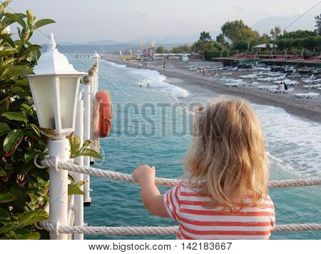 Girl looks at the sea shore